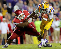 11/14/15<br /> Arkansas Democrat-Gazette/STEPHEN B. THORNTON<br /> Arkansas' DeMarcus Hodge sacks LSU's QB Brandon Harris in the fourth quarter during their game Saturday in Baton Rouge, La.