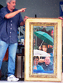 "The bidding starts:  Bad weather didn't stop antique buyers from attending an annual  Founder's Day celebration that featured a live auction.  Antique items from around the state were up for sale and sold to the highest bidder.  ""There were some great deals, so it was worth the trip despite the weather,"" said (name omitted)."