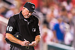 7 October 2017: MLB Umpire Ron Kulpa jots down a player substitution during the second game of the NLDS against the Washington Nationals at Nationals Park in Washington, DC. The Nationals defeated the Cubs 6-3 and even their best of five Postseason series at one game apiece. Mandatory Credit: Ed Wolfstein Photo *** RAW (NEF) Image File Available ***
