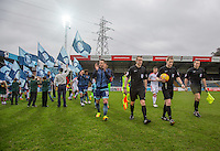 Referee Gavin Ward & his Officials head onto the field followed by Wycombe Captain Matt Bloomfield of Wycombe Wanderers ahead of the Sky Bet League 2 match between Wycombe Wanderers and Crawley Town at Adams Park, High Wycombe, England on 25 February 2017. Photo by Andy Rowland / PRiME Media Images.