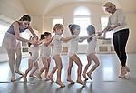 Academy Ballet School assistant Gabi Tripp, left, and Director Eileen Razzetti help their Pre-Ballet students line up in a train.