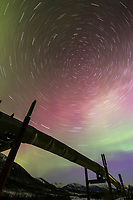 Star trails and the northern Lights, Alaska oil pipeline, Brooks Range in the distance.