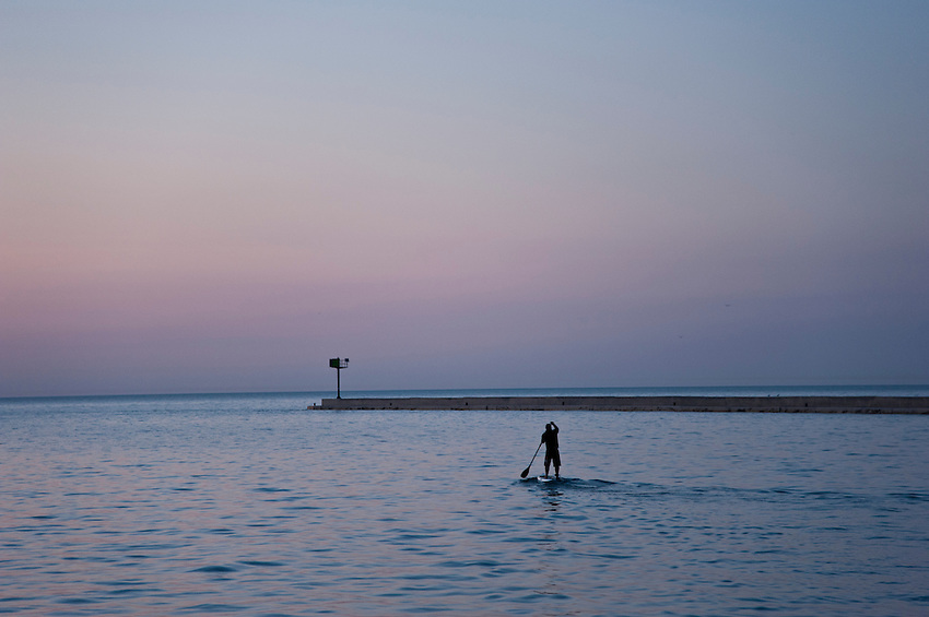 A stand up paddleboard paddler on Lake Superior at Grand Marais Michigan.