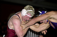 Freshman John Garfinkel wrestles against San Francisco State's Danny Stevens on November 14, 2000 at Burnham Pavilion.