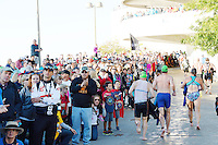 Spectators cheer on the athletes, as they ascend the Monona Terrace ramp, during the 2015 Ironman competition on Sunday, September 13, 2015 in Madison, Wisconsin