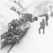 D&amp;RGW work train in Animas Canyon, probably to clear slide. Two bulldozers on flat cars wait to be unloaded.<br /> D&amp;RGW  Animas Canyon, CO  Taken by Norwood, John B. - 2/1952