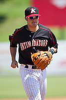Kannapolis Intimidators shortstop Eddy Alvarez (1) jogs off the field between innings of the game against the Lexington Legends at CMC-NorthEast Stadium on August 13, 2014 in Kannapolis, North Carolina.  (Brian Westerholt/Four Seam Images)