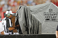 Aug. 28, 2009; Glendale, AZ, USA; NFL referee Tony Corrente checks the screen during an instant replay coaches challenge during the game between the Arizona Cardinals against the Green Bay Packers during a preseason game at University of Phoenix Stadium. Mandatory Credit: Mark J. Rebilas-
