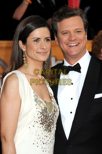 LIVIA GIUGGIOLI & COLIN FIRTH .16th Annual Screen Actors Guild Awards - Arrivals held at The Shrine Auditorium, Los Angeles, California, USA, .23rd January 2010..SAG SAGs half length  married couple husband wife gold dangly earrings black bow tie white sleeveless dress sequined sequins cream tux tuxedo .CAP/ADM/BP.©Byron Purvis/Admedia/Capital Pictures