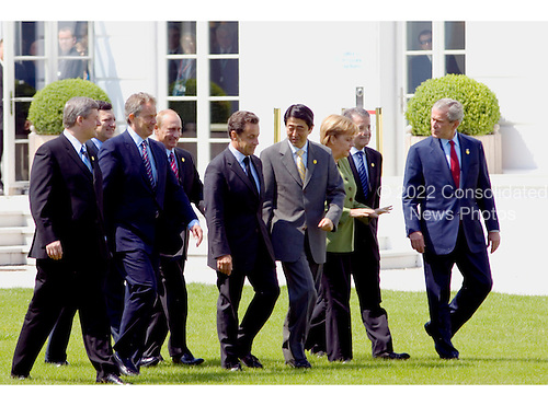 Heiligendamm, Germany - June 7, 2007 -- The G-8 Heads of State and Government walk toward photographers for a group photo in Heiligendamm, Germany on Thursday, June 7, 2007.  From left to right: Prime Minister Stephen Harper of Canada, European Commission President Jose Manuel Barroso, Prime Minister Tony Blair of Great Britain, President Vladimir Putin of Russia, President Nicolas Sarkozy of France, Prime Minister Shinzo Abe of Japan, Chancellor Angela Merkel of Germany, Prime Minister Romano Prodi of Italy, and United States President George W. Bush..Mandatory Credit: BPA via CNP