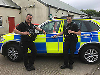 Pictured L-R: Pembrokeshire Armed Response officers, PC's Darren Trevan and John Woodcock <br /> Re: Pembrokeshire Armed Response officers, PC's Darren Trevan and John Woodcock, had a bit of a surprise whilst on patrol in the Carmarthen area this morning after being overtaken by what first appeared to be a speeding motorist.<br /> However, upon speaking to the occupants, it quickly became apparent that one of them, a heavily pregnant lady, was in the very final stages of labour. A quick master-plan was devised where PC Woodcock drove the couple's vehicle to hospital, escorted by PC Trevan, leaving the driver to comfort his partner.<br /> Thankfully they all made it to the nearest hospital just in time for the birth of a lovely baby boy.<br /> Mother, father and baby are all doing well and both officers are recovering from the effects of shock!