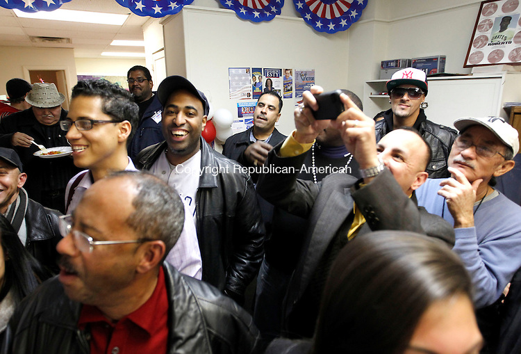 """Waterbury, CT-06 November 2012-110612CM15- Supporters of Victor Cuevas Democratic candidate for the 75th District  celebrate his victory over Republican John """"Jack"""" Alseph Jr. at his headquarters Tuesday night in Waterbury.     Christopher Massa Republican-American"""