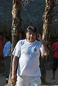 Mato Grosso State, Brazil. Aldeia Metuktire (Kayapo). Megaron Txucarramae, Funai regional administrator.