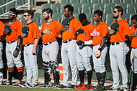 Members of the Augusta GreenJackets stand on the field during the National Anthem prior to the game against the Kannapolis Intimidators at Intimidators Stadium on May 30, 2016 in Kannapolis, North Carolina.  The GreenJackets defeated the Intimidators 5-3.  (Brian Westerholt/Four Seam Images)