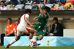 14 June 2006: Zied Jaziri (TUN) (left) challenges Hussein Sulimani (KSA) (right) for the ball. Tunisia tied Saudi Arabia 2-2 at the Allianz Arena in Munich, Germany in match 16, a Group H first round game, of the 2006 FIFA World Cup.