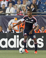 New England Revolution midfielder Juan Agudelo (10) controls the ball. In a Major League Soccer (MLS) match, the New England Revolution (blue) tied D.C. United (white), 0-0, at Gillette Stadium on June 8, 2013.
