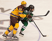 Justin Holl (MN - 12), Michael Parks (North Dakota - 15) - The University of Minnesota Golden Gophers defeated the University of North Dakota 2-1 on Thursday, April 10, 2014, at the Wells Fargo Center in Philadelphia to advance to the Frozen Four final.