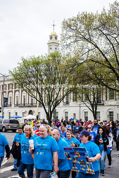 Waterbury, CT- 06 May 2017-050617CM04-  Supporters make their way across Grand Street during the 8th annual Western Connecticut Autism Speaks Walk in Waterbury on Saturday.  Proceeds from the event will support Autism Speaks and for the needs of individuals with autism and their families.  Approximately 1200 supporters attended the event. Christopher Massa Republican-American