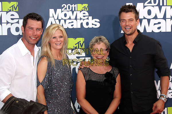 Josh Duhamel & guests .2011 MTV Movie Awards - Arrivals held at Gibson Amphitheatre, Universal City, California, USA..June 5th, 2011.half length shirt family smiling black .CAP/ADM/RE.©Russ Elliot/AdMedia/Capital Pictures.