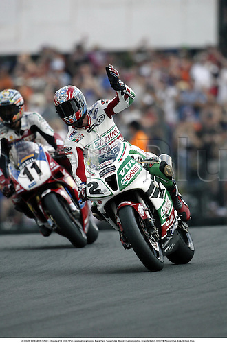 2. COLIN EDWARDS (USA) - (Honda VTR 1000 SP2) celebrates winning Race Two, Superbike World Championship, Brands Hatch 020728 Photo:Glyn Kirk/Action Plus...man rider motorcycle.Superbikes sbk motorsport motorcycling motor.2002 joy celebrate celebrations celebration