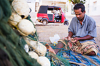 Portrait of a fisherman mending his fishing nets in Negombo, West Coast of Sri Lanka, Asia. This is a portrait of a fisherman mending his fishing nets in Negombo, West Coast of Sri Lanka, Asia.