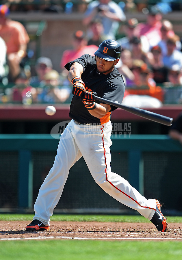 Mar. 28, 2012; Scottsdale, AZ, USA; San Francisco Giants outfielder Melky Cabrera bats in the third inning against the Los Angeles Dodgers at Scottsdale Stadium.  Mandatory Credit: Mark J. Rebilas-