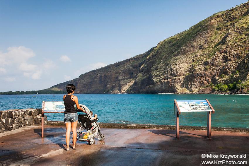 Young woman w/ baby in stroller at Kealakekua Bay, Big Island, Hawaii