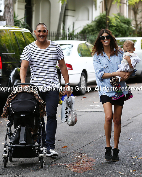2 MARCH 2014 SYDNEY AUSTRALIA<br /> <br /> EXCLUSIVE <br /> <br /> Geoff Huegill pictured with his wife Sara daughter Mila and baby. Geoff handling the baby while Sara carried cute little Mila from the car into their Darlinghurst townhouse after a Sunday morning shopping expedition. Mila was a little camera shy as she hid behind her blankie.<br /> <br /> <br /> *No internet without clearance*<br /> MUST CALL PRIOR TO USE .<br /> +61 2 9211-1088<br /> Matrix Media Group<br /> Note: All editorial images subject to the following: For editorial use only. Additional clearance required for commercial, wireless, internet or promotional use.Images may not be altered or modified. Matrix Media Group makes no representations or warranties regarding names, trademarks or logos appearing in the images.