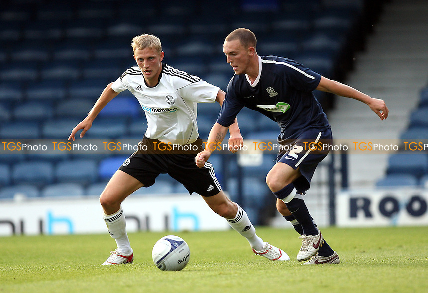Sean Clohessy of Southend (R) and Dean Moxey of Derby - Southend United vs Derby County - Pre-Season Friendly Football Match at Roots Hall, Southend-on-Sea, Essex -  19/07/10 - MANDATORY CREDIT: Gavin Ellis/TGSPHOTO - Self billing applies where appropriate - Tel: 0845 094 6026