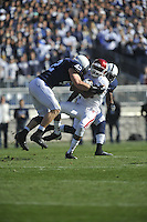 17 November 2012:  Penn State LB Michael Mauti (42) hits Indiana WR Duwyce Wilson (81)..  The Penn State Nittany Lions vs. the Indiana Hoosiers at Beaver Stadium in State College, PA.