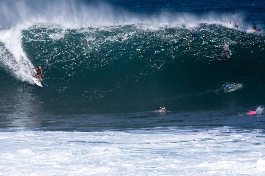 Legendary surfer Michael Ho riding a big wave at Pipeline, North Shore, Oahu
