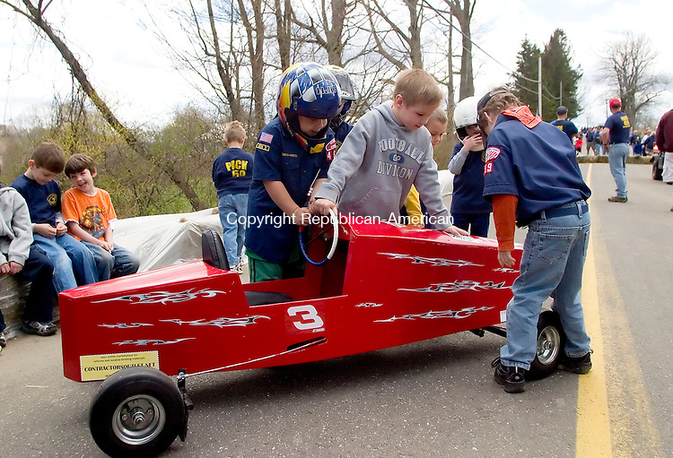 BETHLEHEM, CT- 29 APRIL 07- 042907JT10-<br /> From left, Charles Cassetti, Charlie Schuster, and Quenton Meister check out one of the five soap box cars built by Cub Scout Pack 459 during their 2nd annual Downhill Derby on Hard Hill Road North in Bethlehem on Sunday.<br /> Josalee Thrift Republican-American