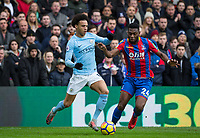 Leroy Sane of Manchester City & Timothy Fosu-Mensah of Crystal Palace during the Premier League match between Crystal Palace and Manchester City at Selhurst Park, London, England on 31 December 2017. Photo by Andy Rowland.