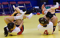 31 MAR 2010 - LONDON, GBR - Britains Holly Lam-Moores and Marie Gerbron stretch after the teams 16-27 loss to Iceland in their 2010 European Womens Handball Championships qualifier .(PHOTO (C) NIGEL FARROW)