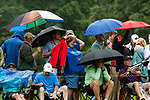 CROMWELL, CT. 20 June 2019-062019 - Spectators put up their umbrellas and rain gear as heavy rain begins to fall, during the first round of the Travelers Championship at TPC River Highlands in Cromwell on Thursday. Bill Shettle Republican-American