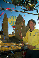 Goreme, Cappadocia, Nevsehir, Turkey. Kaili Kidner navigates Love Valley.  Love Valley is named after its phallic rock formations. A hot air balloon flight is one of the best ways to explore the fairy chimney landscape of Cappadocia and the Gorme National Park. Photo by Frits Meyst / MeystPhoto.com