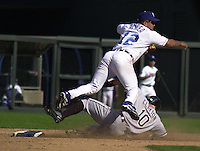 Royals second baseman Luis Alicea turns a double play in the eighth inning as White Sox short stop Royce Clayton slides by at Kauffman Stadium in Kansas City, Missouri on September 30, 2001.  Chicago won 5-2.