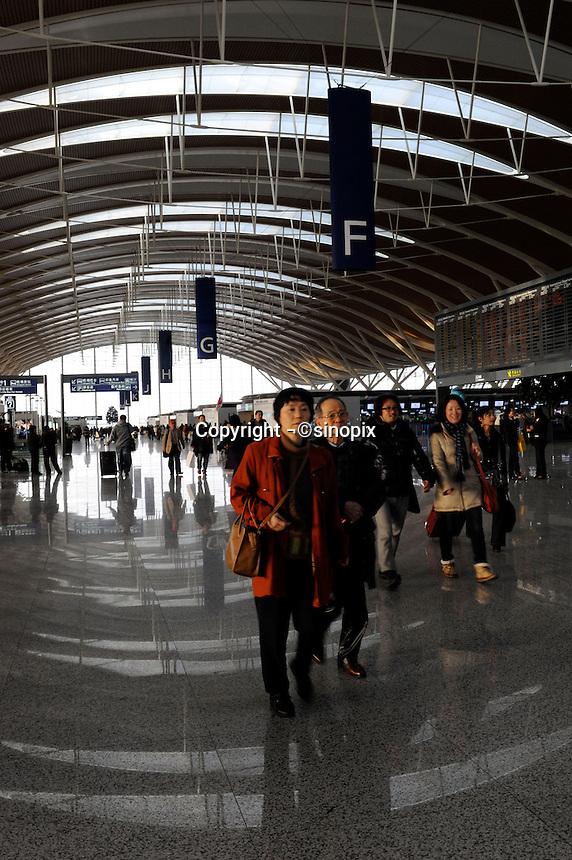 Chinese travllers at Pudong International Airport, Shanghai, China..