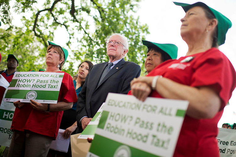 "UNITED STATES - MAY 19: Sen. Bernie Sanders, I-Vt., attends a news conference with members of the National Nurses Association at the Senate swamp on legislation ""to eliminate undergraduate tuition at public colleges and universities and to expand work-study programs,"" May 19, 2015. (Photo By Tom Williams/CQ Roll Call)"