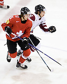 Jeffrey Fuglister (Switzerland - 15), Raimonds Vilkoits (Latvia - 7) - Team Switzerland defeated Team Latvia 7-5 on Wednesday, December 30, 2009, at the Credit Union Centre in Saskatoon, Saskatchewan, during the 2010 World Juniors tournament.