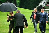 Former United States President George H.W. Bush (2nd,R) walks with  US President George W. Bush as an aide assists first lady Laura Bush with an umbrella as they arrive at the White House from a weekend at the Crawford, Texas ranch, 11 May 2008 in Washington, DC.  Bush, whose daughter Jenna married Henry Hager at the ranch, described the experience as 'spectacular' and 'it's all we could have hoped for'.   <br /> Credit: Mike Theiler / Pool via CNP