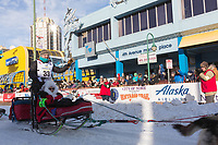Ed Hopkins and team leave the ceremonial start line with an Iditarider at 4th Avenue and D street in downtown Anchorage, Alaska on Saturday March 2nd during the 2019 Iditarod race. Photo by Brendan Smith/SchultzPhoto.com
