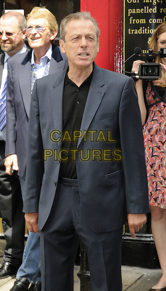 LESLIE GRANTHAM.The Wendy Richard blue plaque unveiling, Shepherd's Tavern, London, England..July 5th, 2009.half length blue black suit jacket shirt .CAP/CAN.©Can Nguyen/Capital Pictures.