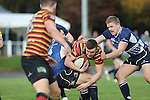 Leinster pair Sam Coghlan-Murray and Steve Crosbie tackle Torrin Myhill.<br /> British &amp; Irish Cup<br /> Carmarthen Quins v Leinster A<br /> Carmarthen Park<br /> 25.10.14<br /> &copy;Steve Pope-SPORTINGWALES