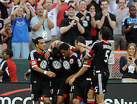D.C. United defender Brandon McDonald (15) celebrates with teammates his score in the 15th minute of the game.  D.C. United defeated The New England Revolution 3-2 at RFK Stadium, Saturday May 26, 2012.