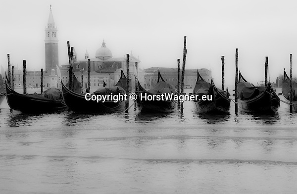 San Marco-Venice-Italy - December 24, 2010 -- Acqua alta, hIgh tides, floods, gondolas tied up -- water, infrastructure, tourism, b&w -- Photo: © HorstWagner.eu