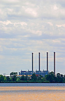 A view from Bourg across the Dordogne river of the oil refinery industrial plant with four chimnies chimney chimneys. It can also be seen from the other side over the Garonne river if one is in Macau Margaux. It marks where Dordogne and Garonne join and become the Gironde estuary  Cotes de Bourg  Bordeaux Gironde Aquitaine France