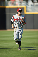 Carolina Mudcats center fielder Tristen Lutz (5) jogs off the field between innings of the game against the Fayetteville Woodpeckers at SEGRA Stadium on May 18, 2019 in Fayetteville, North Carolina. The Mudcats defeated the Woodpeckers 6-4. (Brian Westerholt/Four Seam Images)