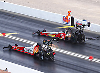 Oct 29, 2016; Las Vegas, NV, USA; NHRA top fuel driver Shawn Langdon (near) alongside Doug Kalitta during qualifying for the Toyota Nationals at The Strip at Las Vegas Motor Speedway. Mandatory Credit: Mark J. Rebilas-USA TODAY Sports