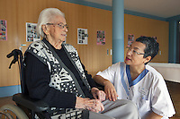 Switzerland. Canton Solothurn. Olten. Dolma Knell works as a nurse in the Marienheim retirement home. She is talking to Aloisa Moser, 84 years old and a permanent resident. The swiss tibetan woman is an Aeschimann's child who arrived 50 years ago in Switzerland to receive custody on a private initiative by an influential Swiss industrialist, Charles Aeschimann. In 1962, Charles Aeschimann agreed with the Dalai Lama to take 200 children and place them in Swiss foster homes and give them a chance for a better life and a good education. Most of the children still had parents in exile or in Tibet, jus a few were orphans. A retirement home – sometimes called an old people's home, although this term can also refer to a nursing home – is a multi-residence housing facility intended for senior citizens. 25.02.2015 © 2015 Didier Ruef